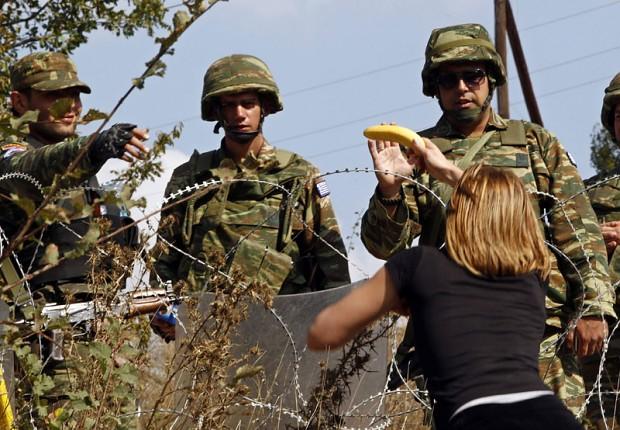 Serbian Reporter helping Greek and Armenian KFOR image